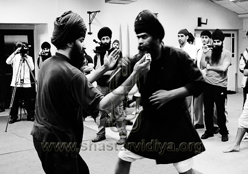 Nidar Singh Nihang demonstrating traditional blade techniques, Birmingham